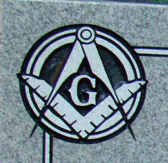 Etched emblem on light grey granite