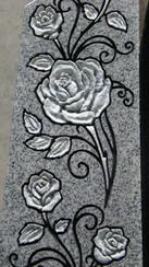 Hand-sculpted roses on light grey granite