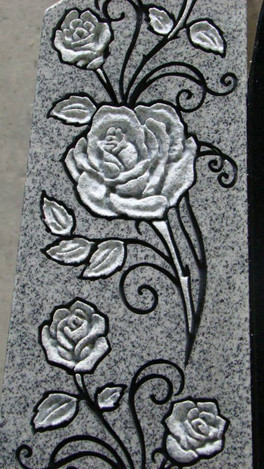 Hand-sculpted roses on light grey granite