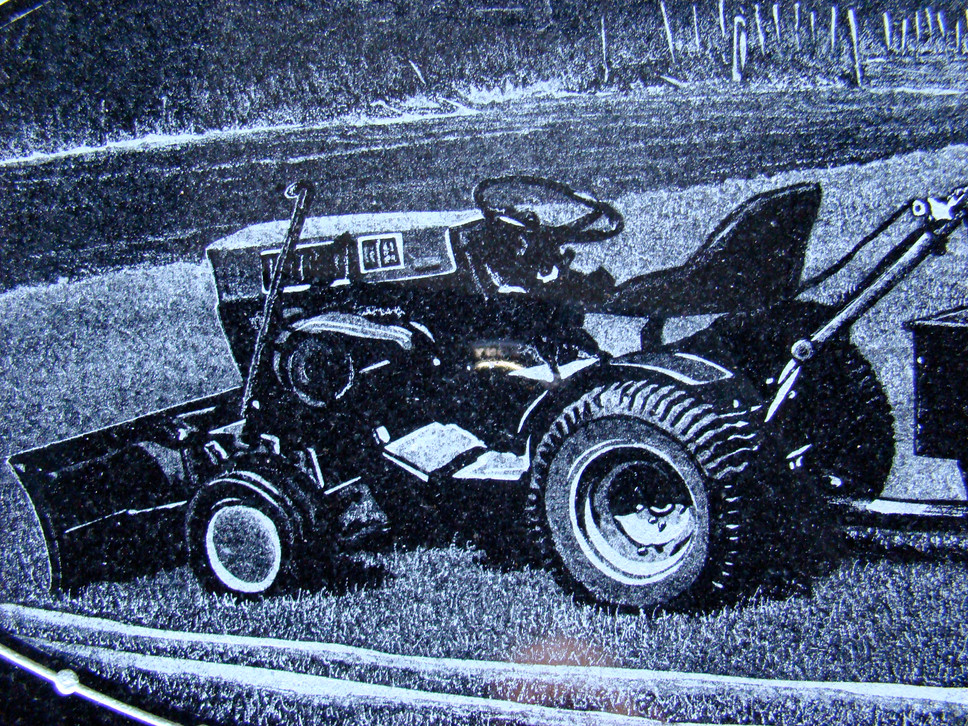 Hand-etched tractor on black granite