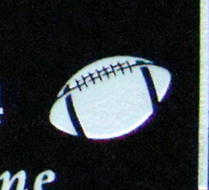 Graphic football image etched in black grnaite