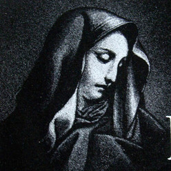 Hand-etched Mother Mary on black granite