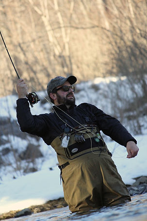 Dan Baughman fights another brown trout on a cold day on the Little Juniata River.