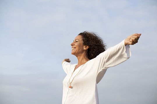 happy woman, taking a deep breath, arms wide open