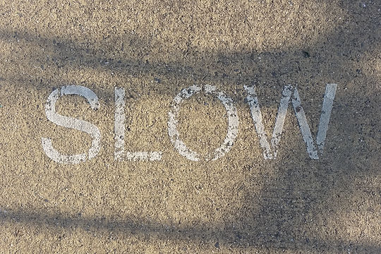 SLOW_stenciled-on-footpath_edited.jpg