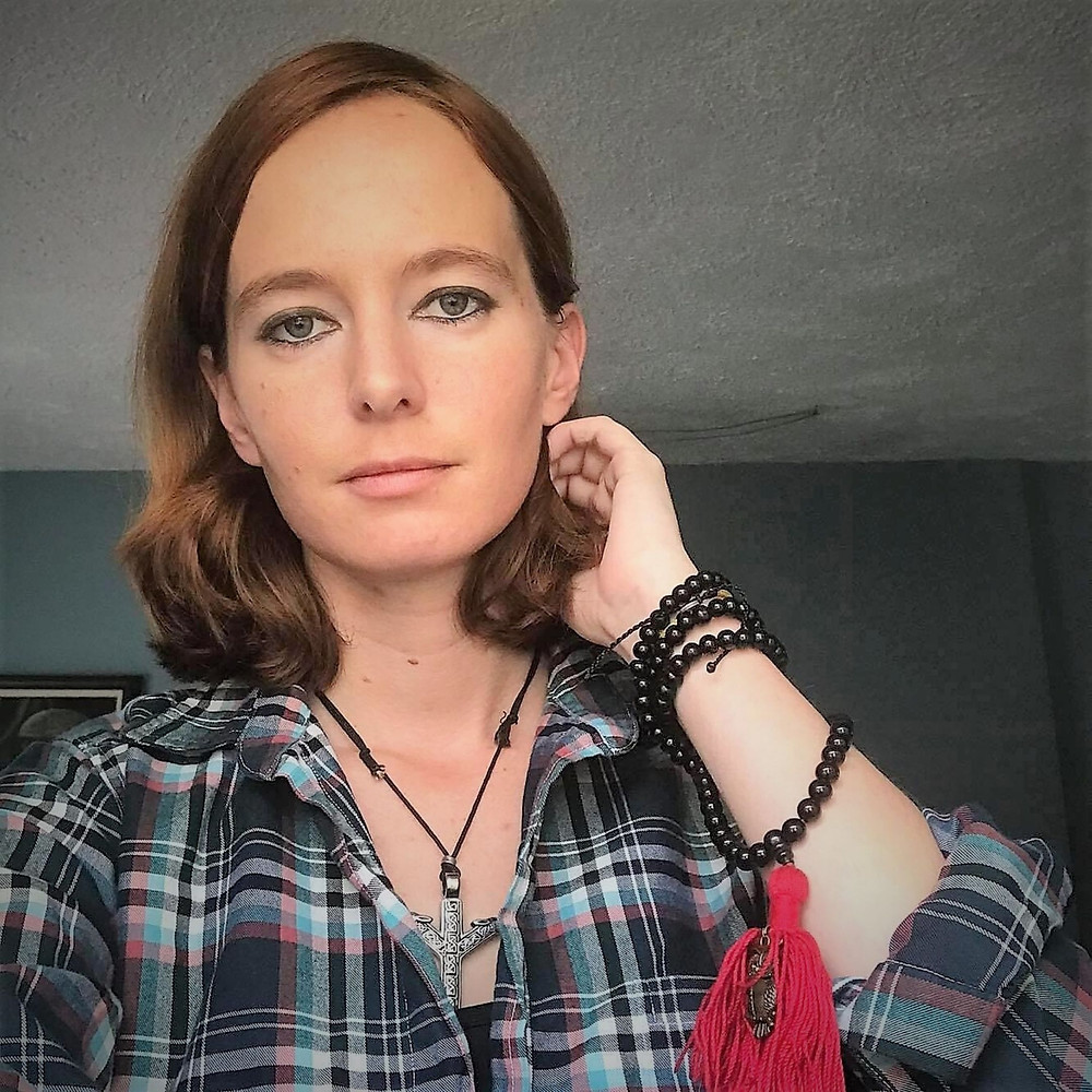 Picture of Nicole in a plaid shirt