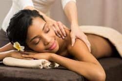 shoulder massage of happy client femaile