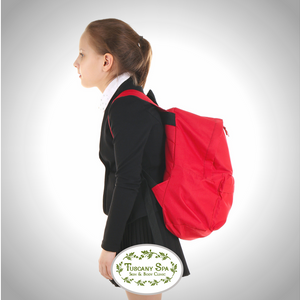 child weighed down by heavy back pack