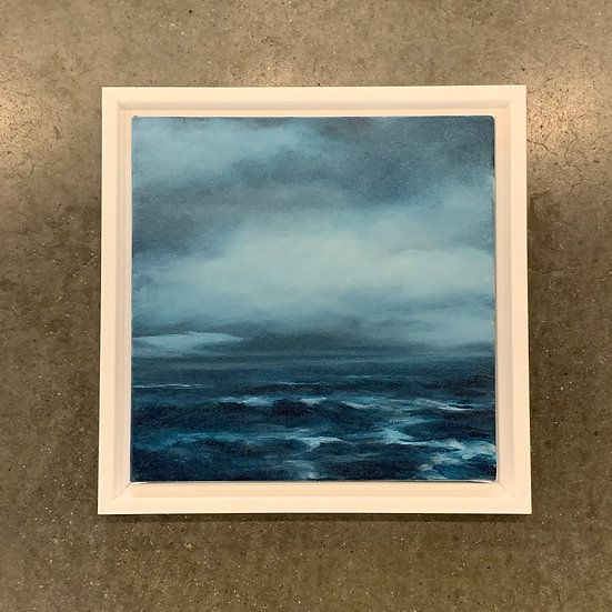 "indigo sea, 10x10"" oil on canvas, framed in white wood floater"