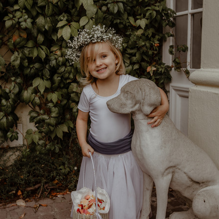 Flower girl with dog statue