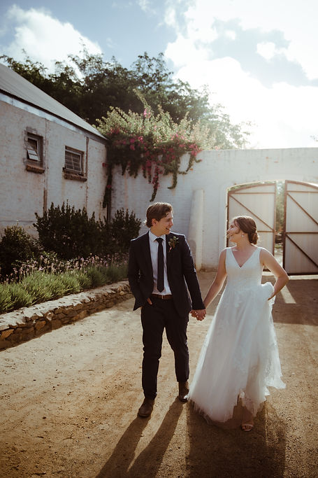 Wedded couple walking at The Dairy shed