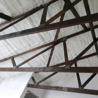 spray foam insulation with stained truss
