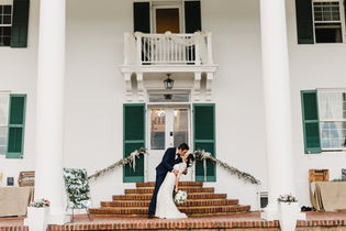 Kiss on the Manor's front porch