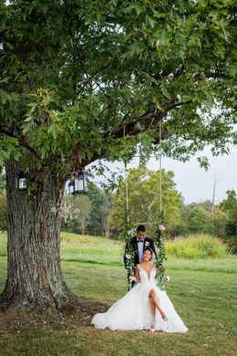 Stunning Bride and Groom on a swing