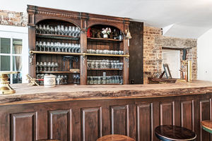 Vintage wooden bar at Rixey Manor