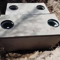 Riser adapters cast into tank