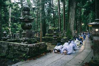 An expression of deep reverence and sincerity: Each morning at 5 o'clock, Compassionate Service Society members bow once for every three steps along the path to Okunoin, where Kobo Daishi, the founder of Shingon Buddhism, is thought to reside in eternal meditation.