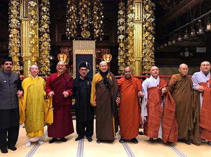 An international show of unity among the Ahmadiyya Muslim Community and different Buddhist traditions. From left: Imam Anees Ahmed Nadeem, Koshin Tomita Sensei, Sogan Rinpoche, Imam Mohammed Zafarullah, Ven. Heng Chang, Bhante Chandasiri, Bop Dueng Sunim, Ven. Heng Der, Hong Jin Sunim.