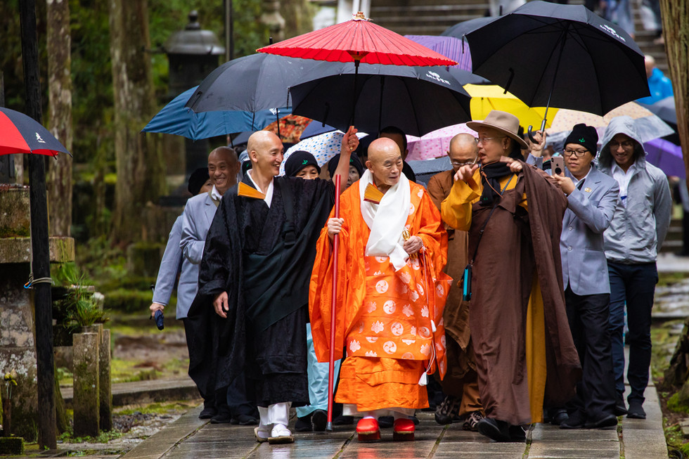 A path of friendship:  Zenryu Hidaka Hoin and Ven. Heng Chang walk the path from Okunoin together as friends in the Dharma.