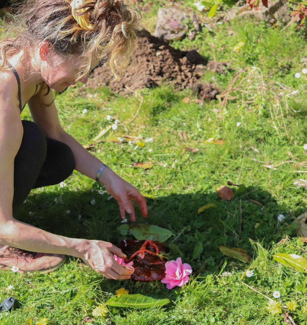 Mother burying placenta