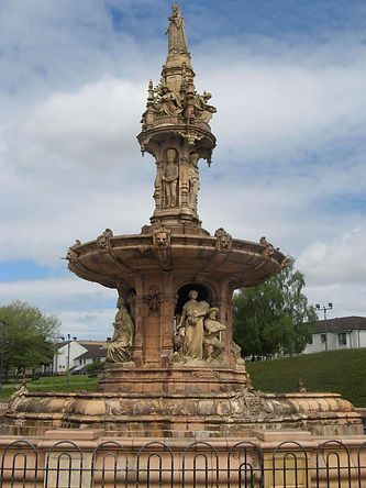 The Doulton Fountain at The People's Palace. An intricately-carved terracotta coloured stone fountain.