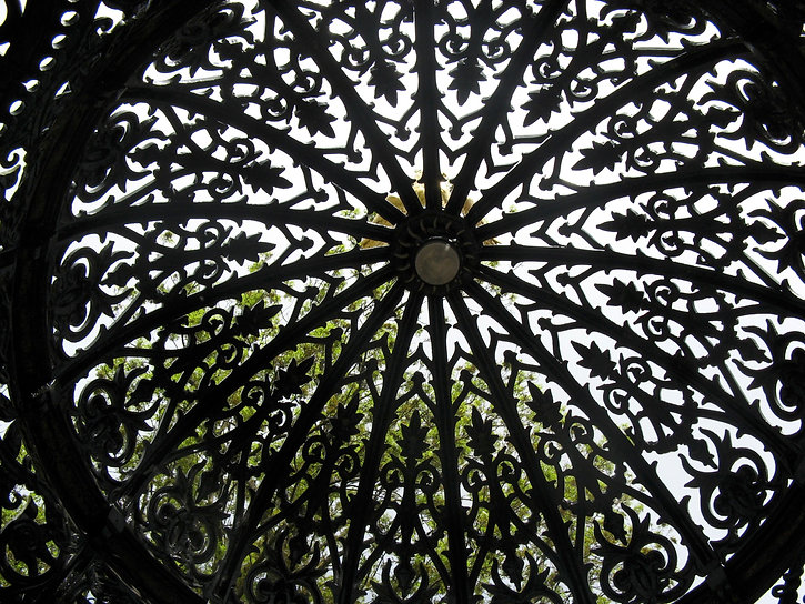 James Martin Fountain and Canopy, designed by Walter Macfarlane.A photograph looking upwards through a patterned metalwork dome.