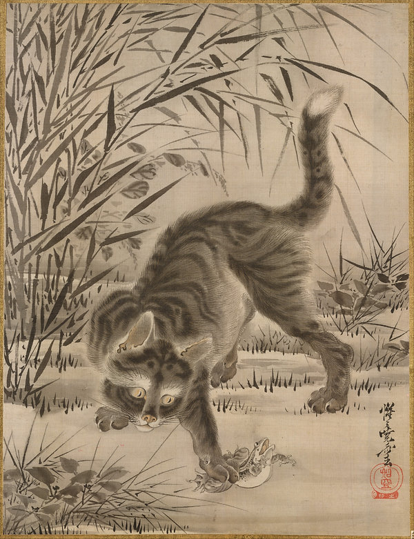 Japanese print of a Cat Catching a Frog by Kawanabe Kyosai. Tall reeds arch over the cat who has a frog caught in its right paw.