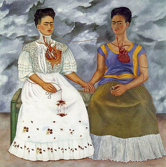 Image: Frida Kahlo, Las Dos Fridas, wikipedia, CC4.0. A painting depicting two versions of the artist, holding hands, with some of their internal organs visible; mainly their hearts. They wear traditional Mexican dress, altough one appears to be more elaborately dressed than theo other. The sky behind them looks stormy with billowing grey clouds.