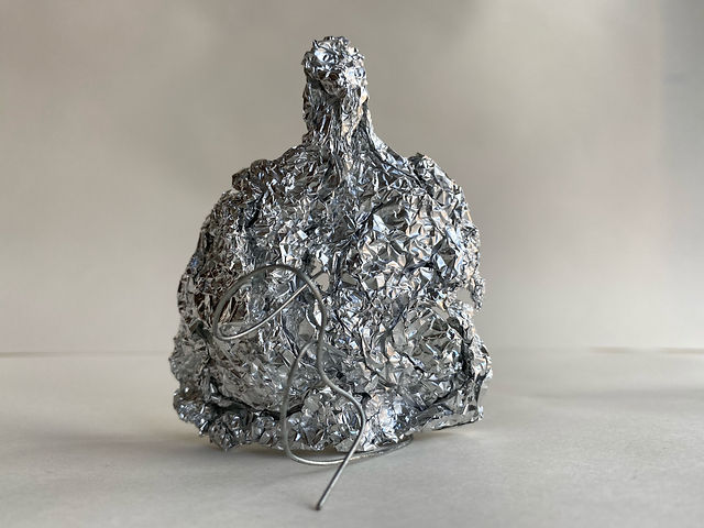 John Cameron at Greenfield Park Care Home, untitled sculpture, 2021, mixed media. The sculpture resembles the head and torso of a figure made from scrunched foil and with wire details extending from the main body of the sculpture.