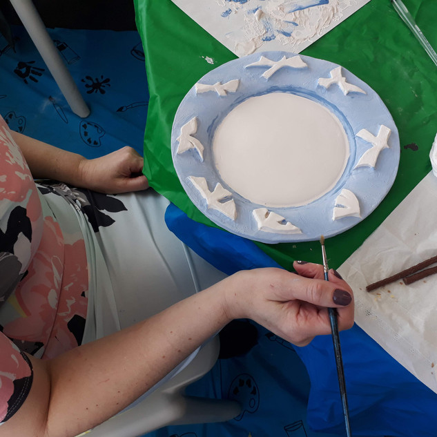 Image: Ceramic Workshop with Robyn Walsh of Surface_Studios and Harriet Tritton. Hand glazing earthenware ceramic plate. To celebrate inspirational women for International Women's Day 2019.