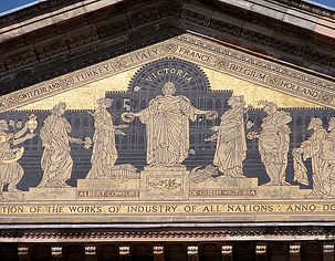 Image: Frieze detail from internal courtyard showing Queen Victoria in front of the 1851 Great Exhibition  (CC use). The photograph depicts a portion of the frieze and is gold and black.