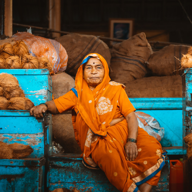 Woman sitting on containers Photo by Sankalpa Joshi from pexels