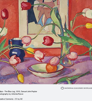 Samuel John Peploe, Tulips - The Blue Jug, 1910-1911. A painting with vivid colours of a still life including many tulips, fruit bowl with an orange, a blue jug, all sitting on a purple tablecloth, and a muted painting in the packground sitting on a bright red wall.