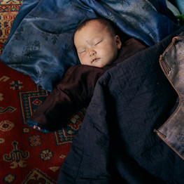 Infant In Warm Clothes Sleeping Photo by ArtHouse Studio from Pexels