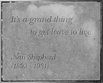 Image: Nan Shepherd's stone slab outside the Writers' Museum in Edinburgh. It reads IT'S A GRAND THINK TO GET LEAVE TO LIVE. NAN SHEPHERD (1893 - 1981)