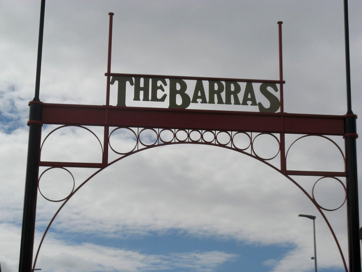 The Barras Market entrance gate. THE BARRAS in metalwork sits above the arched entrance.
