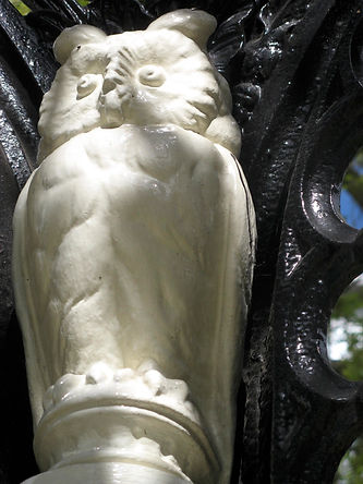 Owl from James Martin Fountain and Canopy, designed by Walter Macfarlane. A white coated metal owl.