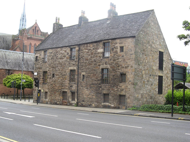 The Provand's Lordship: One of the oldest buildings in Glasgow, it was built in 1419. Stone building with small windows and slate roof.