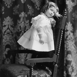 Small Girl Standing on a Chair Photograp