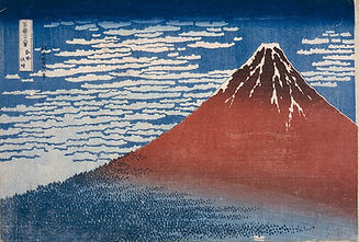 A woodblock print of a rust-red coluored mountain with veins of snow at the top, dominating the picture, with the peak rising on the right hand side. The sky is blue with white stylised soft clouds. The bottom of the mountain is shades of blue with small patterns reminiscant of trees. The whole image has a flattened look, due to the print technique.