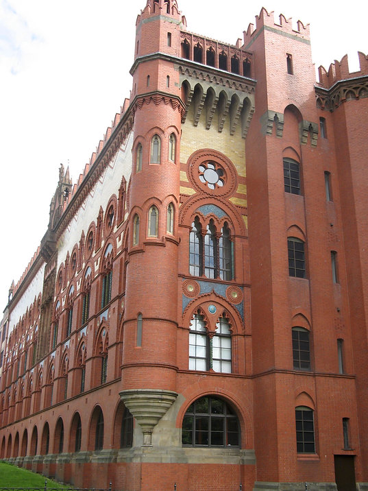 Templeton's Carpet Factory. A large, distinctive red brick building that has paler gold brick and slate coloured areas of pattern. It's an unusual building, with Venetian influence, turret type roof elements.