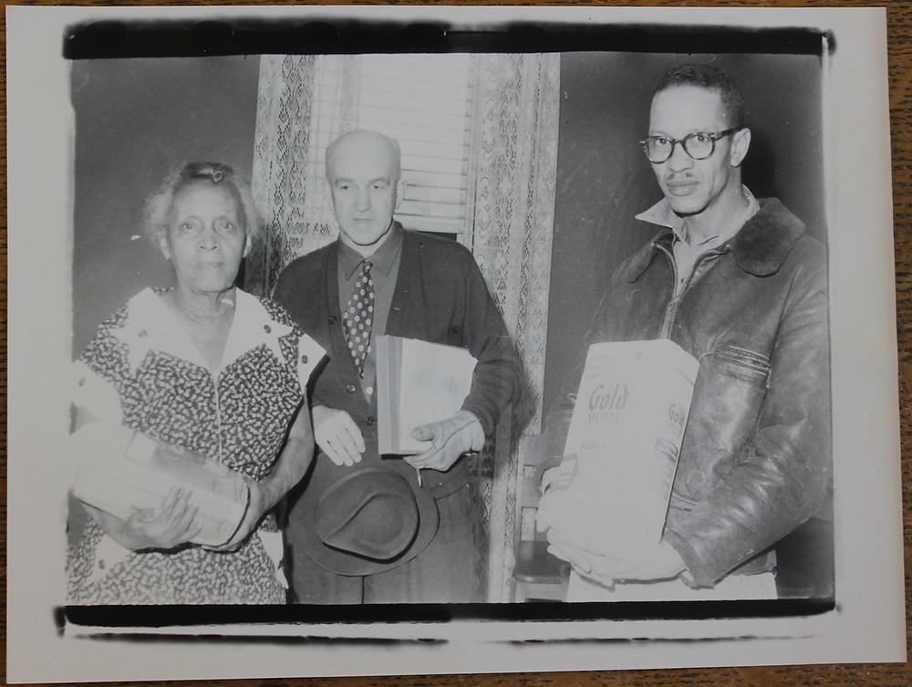 Kahoe & Benning giving sacks of flour to Mrs. Bertha Baker of Yellow Springs.