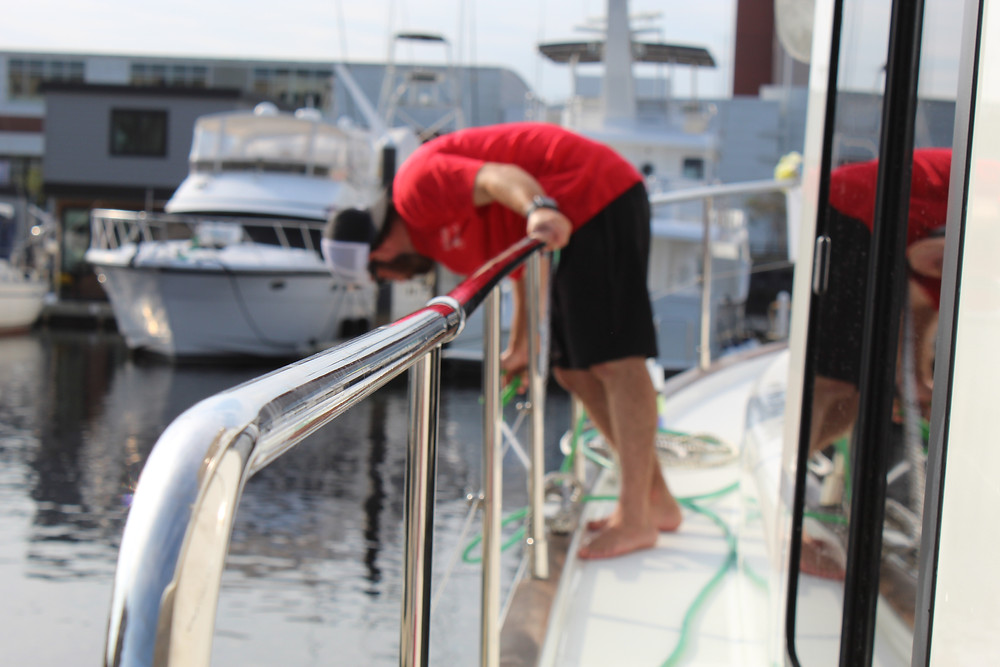 J&J Employee Washing a Boat