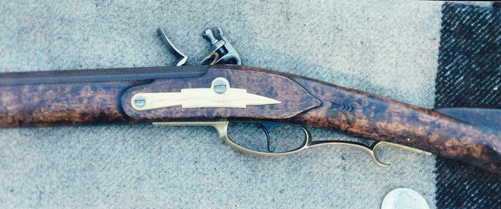 Hand-carved, hand-engraved and hand-assembled flintlock rifle by Fiddlin' Red Simpson.