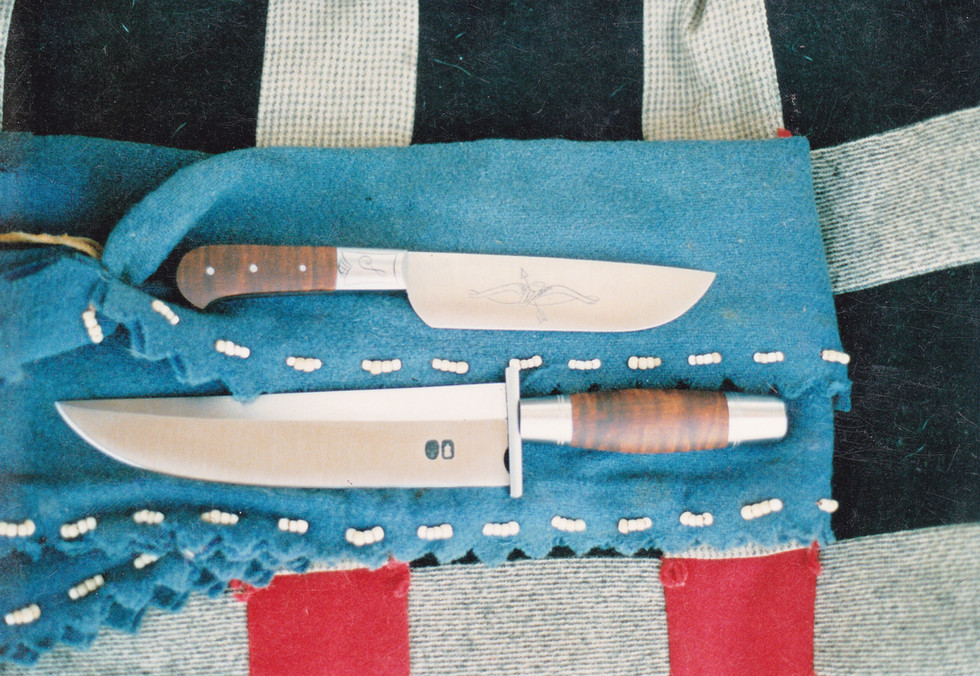 Two frontier-style knives -- hand forged, filed, engraved and finished.