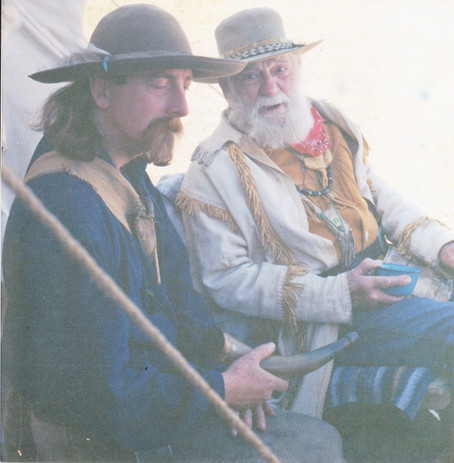 Discussing powderhorns with an old timer in 1991.