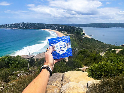 Lil Bucks Cacao pouch pictured with the ocean as its background