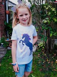 Evie in the Unicorn tee