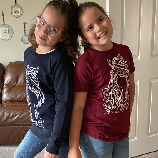 Edie and Maisey rocking the Horse designs