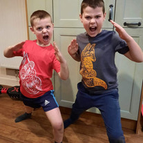 Fox and sloth tees worn by Adam and Thomas